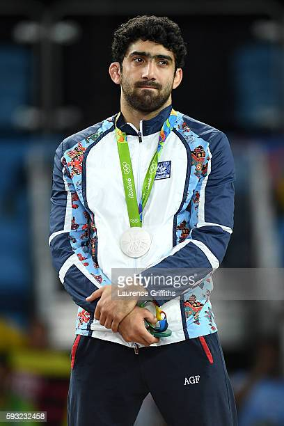 Silver medalist Toghrul Asgarov of Azerbaijan stands on the podium during the medal ceremony for the Men's Freestyle 65kg event on Day 16 of the Rio...
