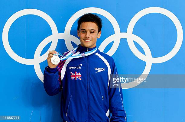 Silver medalist Tom Daley of Great Britain poses after the Men's 10m Platform Final during day two of the FINA Diving World Series Beijing Station at...