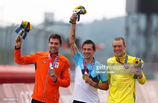 Silver medalist Tom Dumoulin of Team Netherlands, gold medalist Primoz Roglic of Team Slovenia, and bronze medalist Rohan Dennis of Team Australia,...