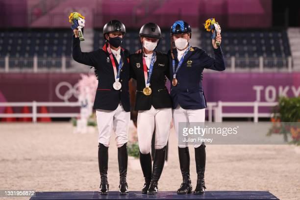 Silver medalist Tom McEwen of Team Great Britain, gold medalist Julia Krajewski of Team Germany and bronze medalist Andrew Hoy of Team Australia pose...