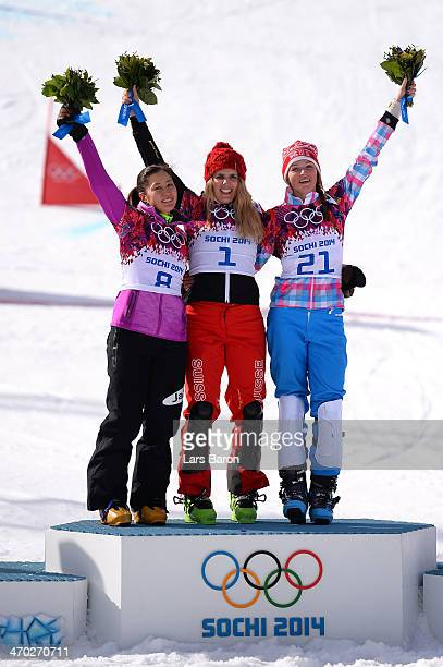 Silver medalist Tomoka Takeuchi of Japan gold medalist Patrizia Kummer of Switzerland and bronze medalist Alena Zavarzina of Russia celebrate on the...