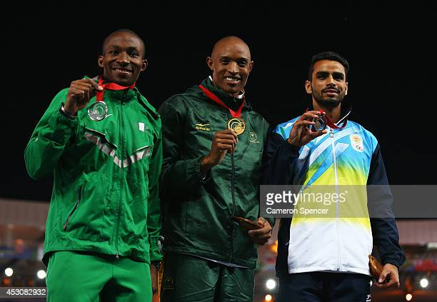Silver medalist Tosin Oke of Nigeria, gold medalist Khotso Mokoena of South Africa and bronze medalist Arpinder Arpinder Singh of India pose on the...