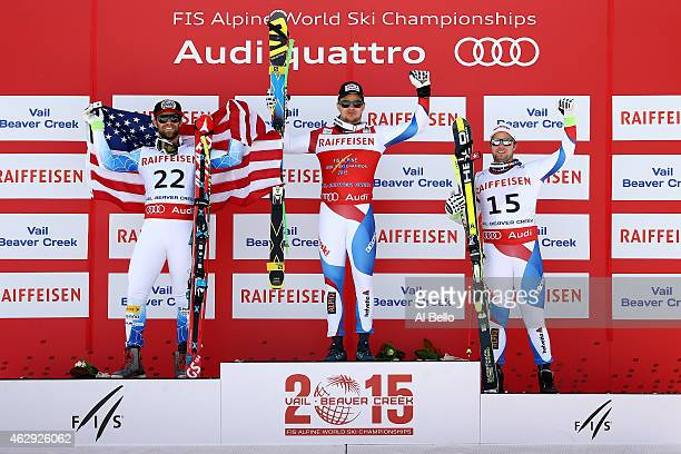 Silver medalist Travis Ganong of the United States gold medalist Patrick Kueng of Switzerland and bronze medalist Beat Feuz of Switzerland stand on...