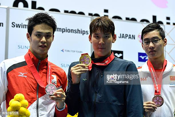 Silver medalist Tsubasa Amai of Japan and Gold medalis Taehwan Park of South Korea and Breonze Medalist QIU Ziao of China pose for photographs after...