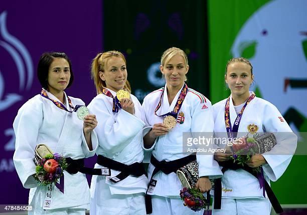 Silver medalist Turkey's Ebru Sahin and Belgium's Charline van Snick pose after their women's 48kg judo final match at the Baku 2015 European Games...