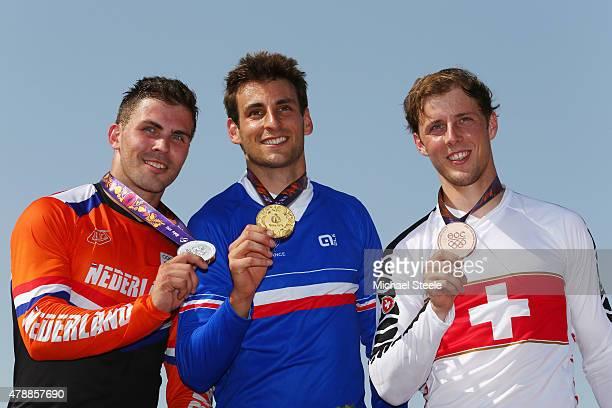 Silver medalist Twan van Gendt of the Netherlands gold medalist Joris Daudet of France and David Graf of Switzerland pose on the medal podium...