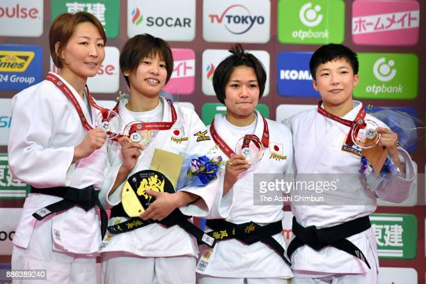 Silver medalist Urantsetseg Munkhbat of Mongolia gold medalist Ami Kondo bronze medalists Funa Tonaki and Jeong Bokyeong of South Korea pose on the...
