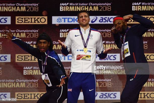 Silver medalist US athlete Jarret Eaton gold medalist Britain's Andrew Pozzi and France's Aurel Manga pose on the podium during the medal ceremony...