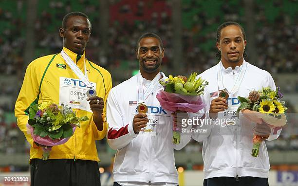 Silver medalist Usain Bolt of Jamaica gold medalist Tyson Gay of the United States of America and bronze medalist Wallace Spearmon of the United...