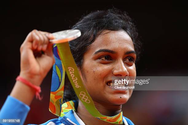 Silver medalist V. Sindhu Pusarla of India celebrates during the medal ceremony after the Women's Singles Badminton competition on Day 14 of the Rio...