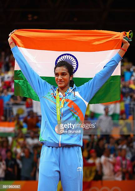 Silver medalist V Sindhu Pusarla of India celebrates during the medal ceremony after the Women's Singles Badminton competition on Day 14 of the Rio...