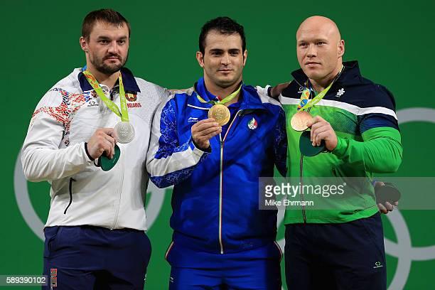 Silver medalist Vadzim Straltsou of Belarus gold medalist Sohrab Moradi of the Islamic Republic of Iran and silver medalist Vadzim Straltsou of...