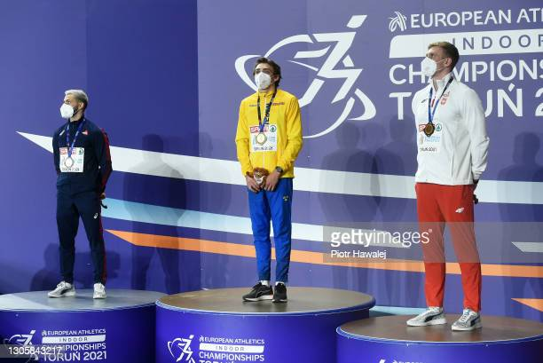Silver medalist Valentin Lavillenie of France, gold medalist Armand Duplantis of Sweden and bronze medalist Piotr Lisek of Poland pose for a photo...