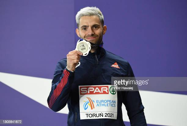 Silver medalist Valentin Lavillenie of France poses for a photo during the medal ceremony for the Men's Pole Vault final during the second session on...