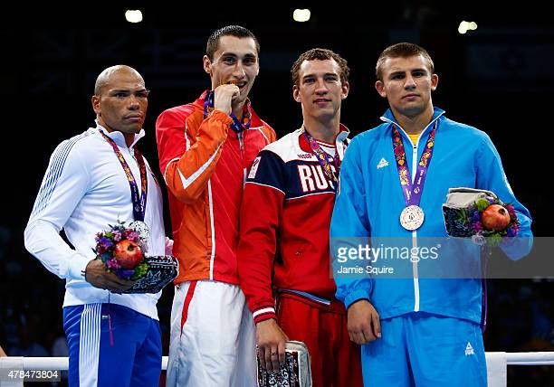 Silver medalist Valentino Manfredonia of Italy gold medalist Teymur Mammadov of Azerbaijan and bronze medalists Pavel Silyagin of Russia and...