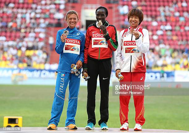 Silver medalist Valeria Straneo of Italy, gold medalist Edna Ngeringwony Kiplagat of Kenya and bronze medalist Kayoko Fukushi of Japan stand on the...