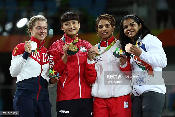 Silver medalist Valeriia Koblova Zholobova of Russia gold medalist Kaori Icho of Japan bronze medalist Marwa Amri of Tunisia and bronze medalist...