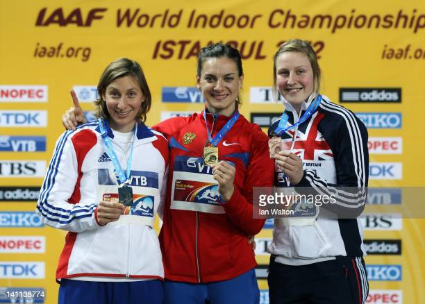 Silver medalist Vanessa Boslak of France gold medalist Elena Isinbaeva of Russia and bronze medalist Holly Bleasdale of Great Britain stand on the...