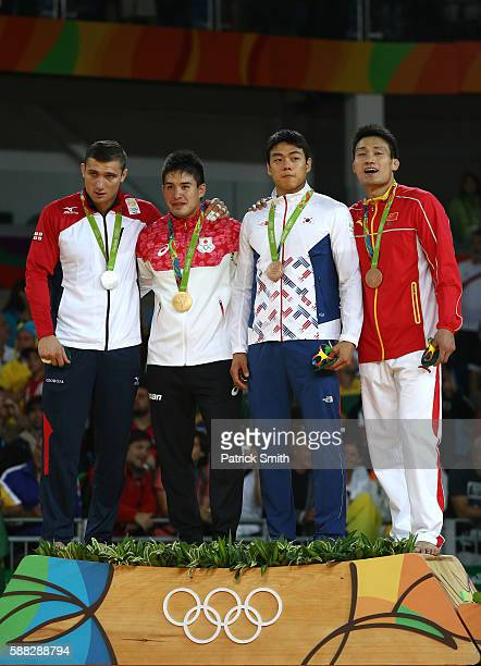 Silver medalist Varlam Liparteliani of Georgia gold medalist Mashu Baker of Japan bronze medalist A Donghan Gwak of Korea and bronze medalist B...