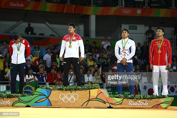 Silver medalist Varlam Liparteliani of Georgia gold medalist Mashu Baker of Japan bronze medalist A Donghan Gwak of Korea and bronze medalist B...