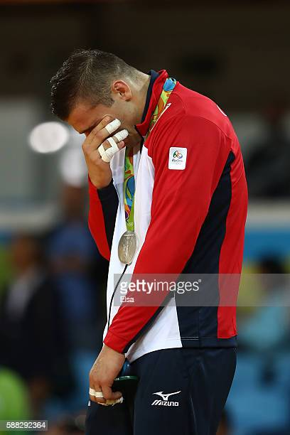 Silver medalist Varlam Liparteliani of Georgia stands on the podium during the medal ceremony for the Men's 90kg Judo on Day 5 of the Rio 2016...