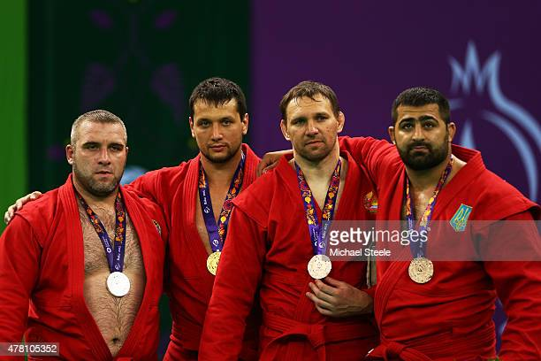 Silver medalist Vasif Safarbayov of Azerbaijan gold medalist Artem Osipenko of Russia and bronze medalists Yury Rybak of Belarus and Razmik Tonoyan...