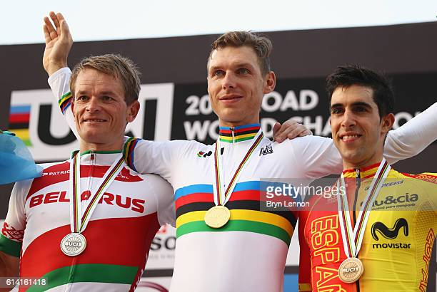 Silver medalist Vasil Kiryienka of Belarus, gold medalist Tony Martin of Germany and bronze medalist Jonathan Castroviejo Nicolas of Spain celebrate...