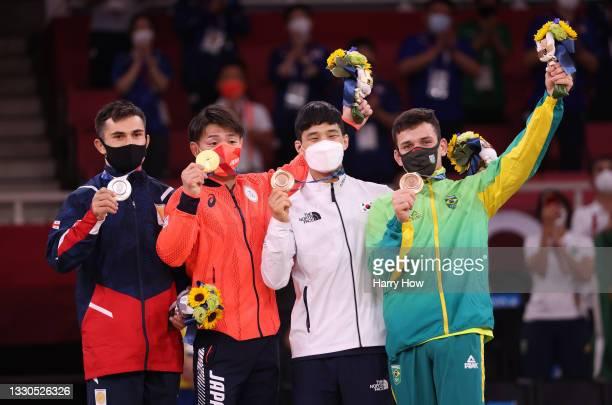 Silver medalist Vazha Margvelashvili of Team Georgia, gold medalist Hifumi Abe of Team Japan, bronze medalist A Baul An of Team Republic of Korea and...