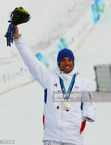 Silver medalist Vincent GauthierManuel of France celebrates at the medal ceremony for the Men's Standing Super Combined during Day 9 of the 2010...