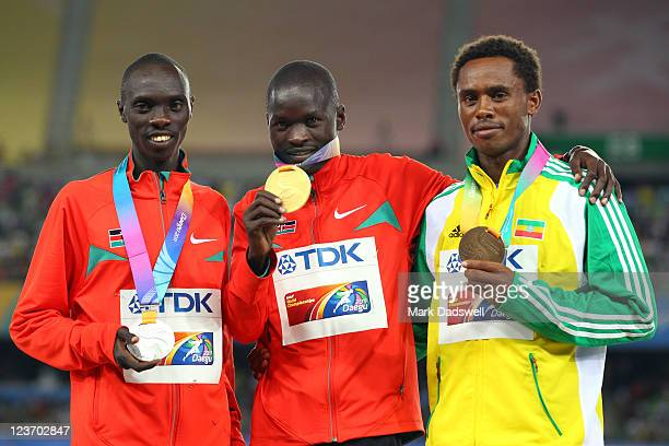 Silver medalist Vincent Kipruto of Kenya gold medalist Abel Kirui of Kenya and bronze medalist Feyisa Lilesa of Ethiopia celebrate on the podium with...