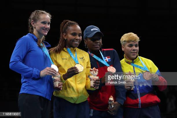 Silver medalist Virginia Fuchs of United States gold medalist Ingrit Valencia Victoria and bronze medalists Miguelina Hernandez of Dominican Republic...