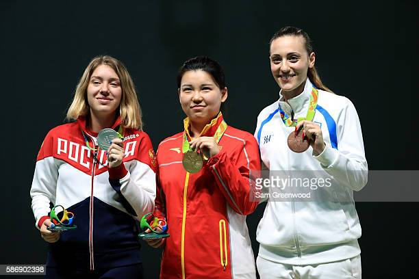 Silver Medalist Vitalina Batsarashkina of Russia gold medalist Mengxue of China and bronze medalist Anna Korakaki of Greece pose on the podium during...