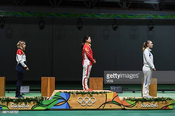 Silver Medalist Vitalina Batsarashkina of Russia gold medalist Zhang Mengxue of China and bronze medalist Anna Korakaki of Greece pose on the podium...