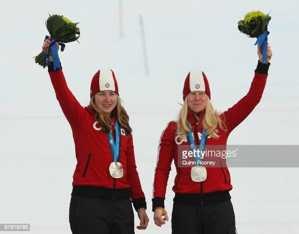 Silver medalist Viviane Forest of Canada and guide Lindsay Debou celebrate at the medal ceremony for the Women's Visually Impaired Super Combined...