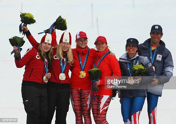 Silver medalist Viviane Forest of Canada and guide Lindsay Debou gold medalist Henrieta Farkasova of Slovakia and guide Natalia Subrtova and bronze...