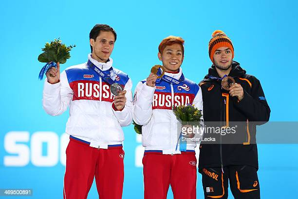 Silver medalist Vladimir Grigorev of Russia gold medalist Victor An of Russia and bronze medalist Sjinkie Knegt of the Netherlands on the podium...