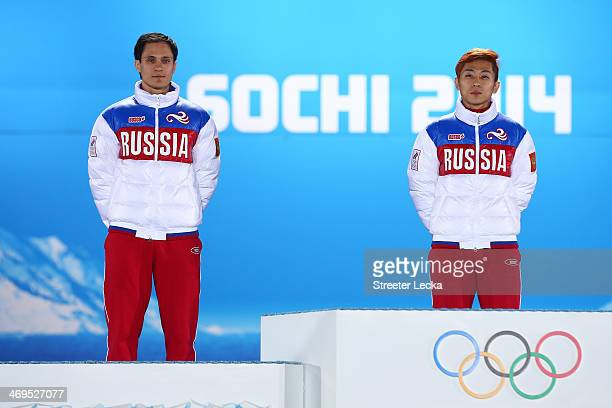 Silver medalist Vladimir Grigorev of Russia gold medalist Victor An of Russia celebrate on the podium during the medal ceremony for Short Track Speed...