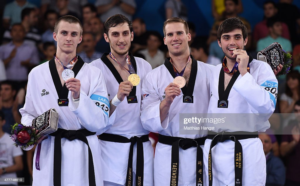 Silver medalist Vladislav Larin of Russia, gold medalist Radik Isaev of Azerbaijan and bronze medalists Vedran Golec of Croatia and Daniel Ros Gomez of Spain pose during the medal ceremony for the Men's +80kg Taekwondo on day seven of the Baku 2015 European Games at the Crystal Hall on June 19, 2015 in Baku, Azerbaijan.