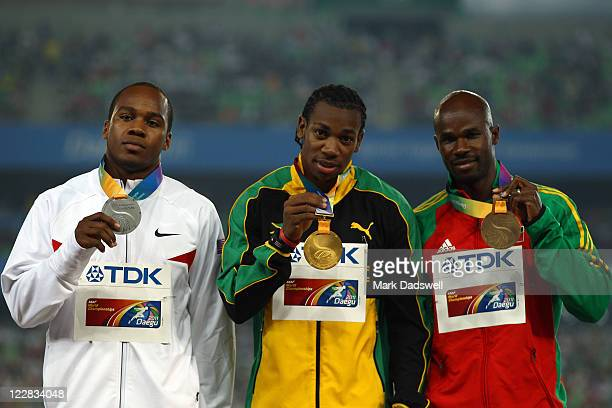 Silver medalist Walter Dix of United States gold medalist Yohan Blake of Jamaica and bronze medalist Kim Collins of Saint Kitts and Nevis celebrate...