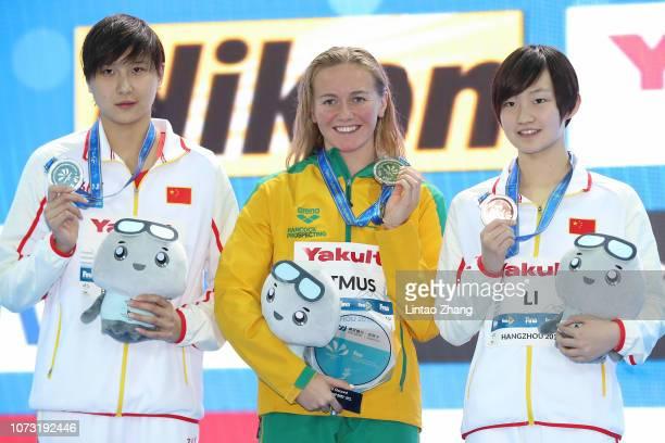 Silver medalist Wang Jianjiahe of China Gold medalist and new world record holder Ariarne Titmus of Australia and bronze medalist Li Bingjie of China...