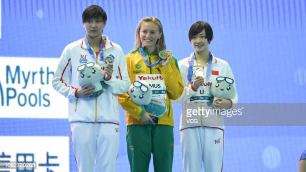 Silver medalist Wang Jianjiahe of China gold medalist Ariarne Titmus of Australia and bronze medalist Li Bingjie of China pose with medals on the...