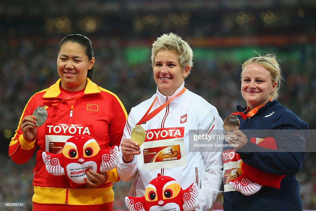 Silver medalist Wenxiu Zhang of China, gold medalist Anita Wlodarczyk of Poland and bronze medalist Alexandra Tavernier of France pose on the podium during the medal ceremony for the Women's Hammer final during day six of the 15th IAAF World Athletics Championships Beijing 2015 at Beijing National Stadium on August 27, 2015 in Beijing, China.
