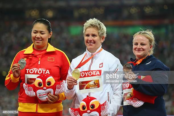 Silver medalist Wenxiu Zhang of China gold medalist Anita Wlodarczyk of Poland and bronze medalist Alexandra Tavernier of France pose on the podium...