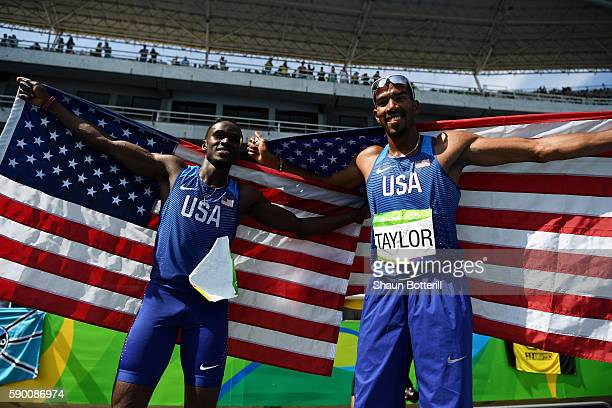 Silver medalist Will Claye of the United States and gold medalist Christian Taylor of the United States pose after the Men's Triple Jump Final on Day...