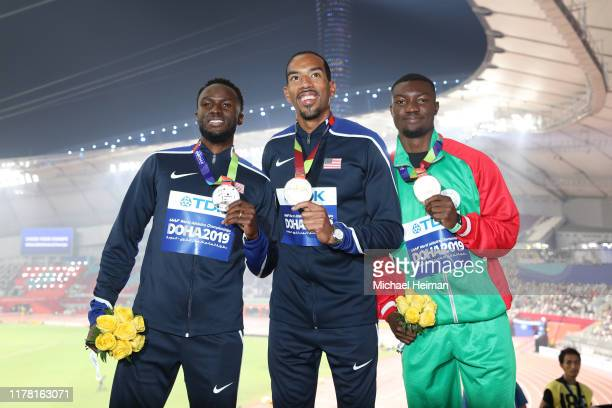 Silver medalist Will Claye of the United States, gold medalist Christian Taylor of the United States and bronze medalist Hugues Fabrice Zango of...
