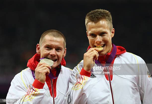 Silver medalist Wojtek Czyz of Germany and gold medalist Markus Rehm of Germany pose on the podium during the medal ceremony for the Men's Long Jump...