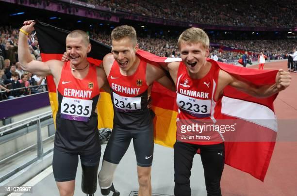 Silver medalist Wojtek Czyz of Germany gold medalist Markus Rehm of Germany and bronze medalist Daniel Jorgensen of Denmark celebrate after the the...
