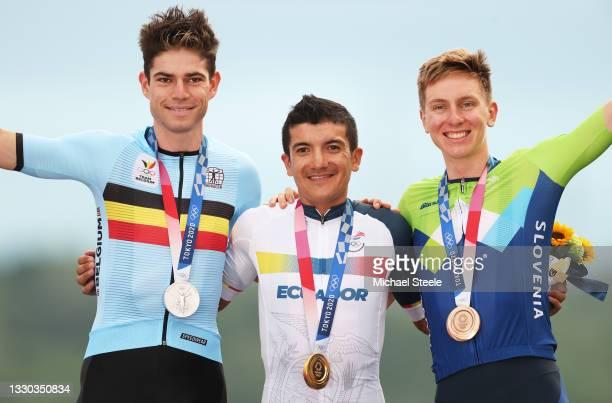 Silver medalist Wout van Aert of Team Belgium, gold medalist Richard Carapaz of Team Ecuador, and bronze medalist Tadej Pogacar of Team Slovenia,...