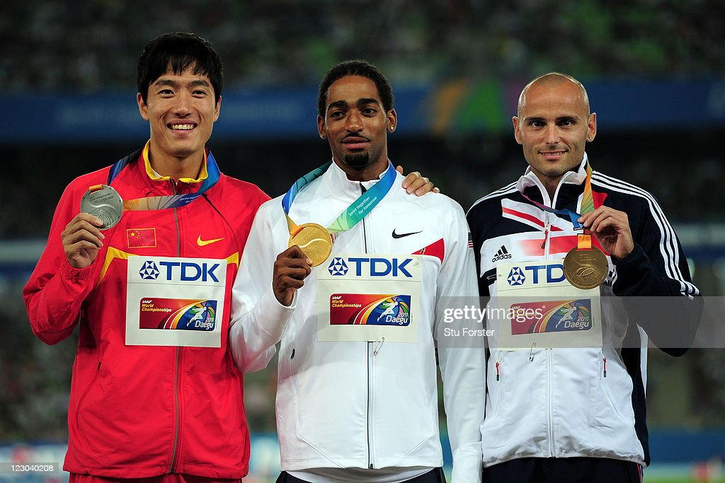 Silver medalist Xiang Liu of China, gold medalist Jason Richardson of United States and bronze medalist Andrew Turner of Great Britain celebrate on the podium with their medals for the men's 110 metres hurdles during day four of 13th IAAF World Athletics Championships at Daegu Stadium on August 30, 2011 in Daegu, South Korea.