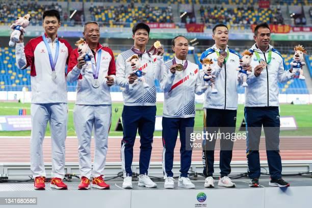 Silver medalist Xie Zhenye of Zhejiang and his coach Tao Jianrong, gold medalist Su Bingtian of Guangdong and his coach Yuan Guoqiang, bronze...